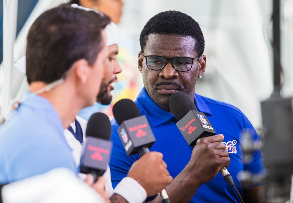 NFL Hall of Famer, sports commentator and former Dallas Cowboys wide receiver Michael Irvin interviews Dallas Cowboys quarterback Dak Prescott (4) during a morning practice at training camp in Oxnard, California on Tuesday, July 30, 2019. (Ashley Landis/The Dallas Morning News)