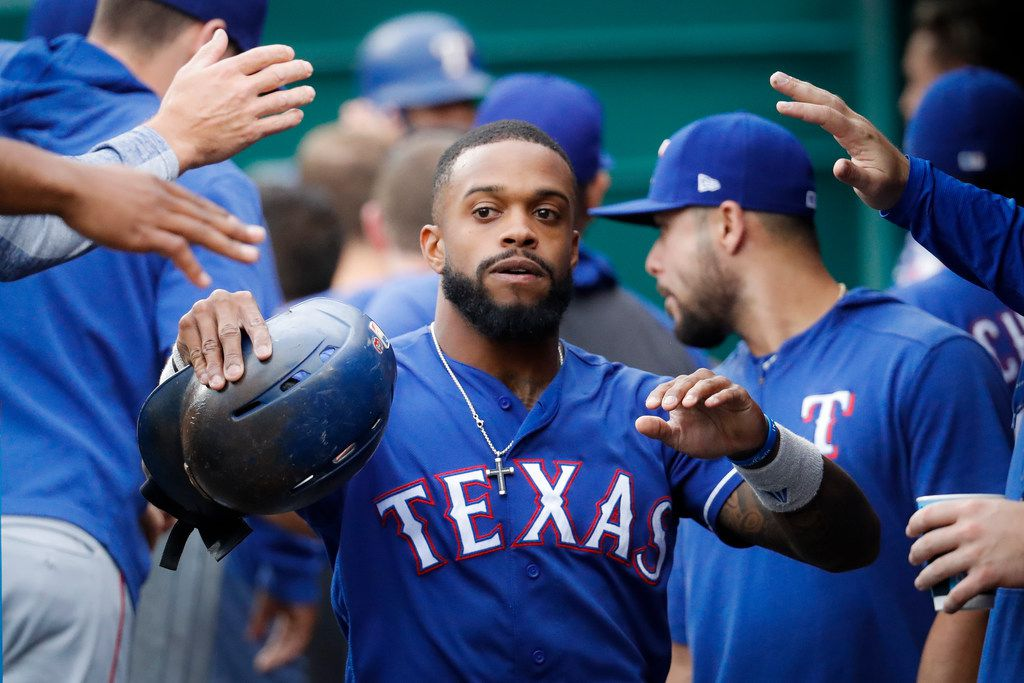 Texas Rangers' Delino DeShields celebrates in the dugout after scoring in the first inning of a baseball game against the Cincinnati Reds, Friday, June 14, 2019, in Cincinnati. (AP Photo/John Minchillo)