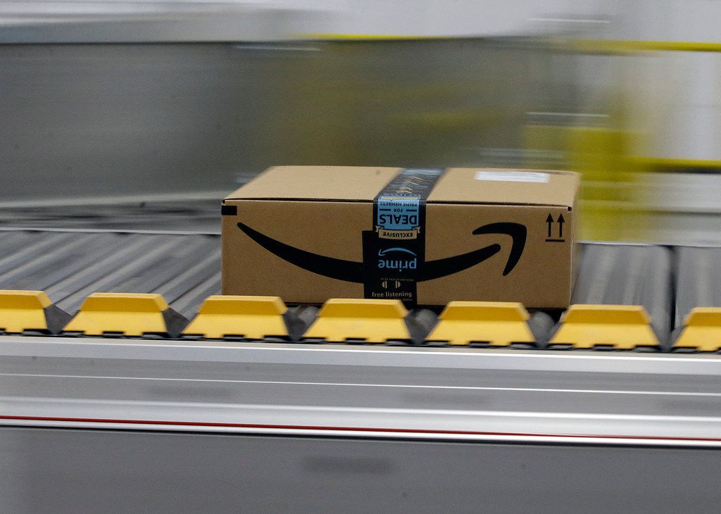 In this 2018 file photo, a box for an Amazon prime customer moves through the new Amazon Fulfillment Center in Sacramento, Calif.