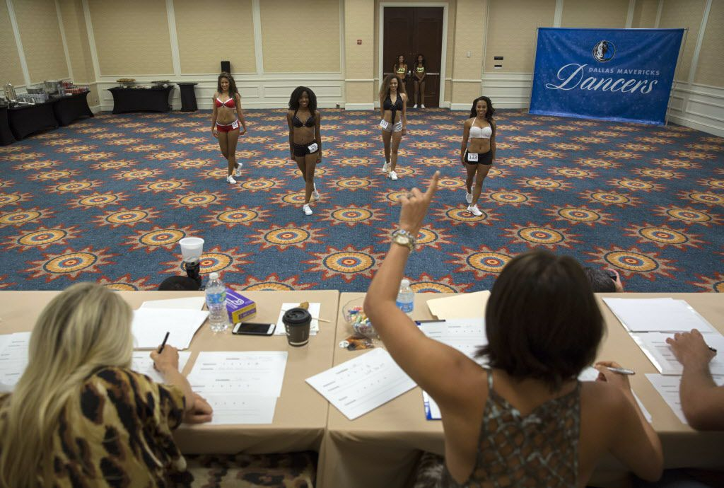 Judge Mallory Mills (right) gives a countdown to dancers during final auditions to join the 2015-2016 Dallas Mavericks Dancers team Sunday, July 12, 2015 in Dallas. More than 40 women made it to the finals, vying for a spot to take part in a training camp later in the week.