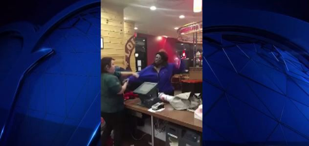 A woman takes a swing at a Popeyes employee in Fort Worth in this still image from surveillance video on Monday, Nov. 26, 2018.