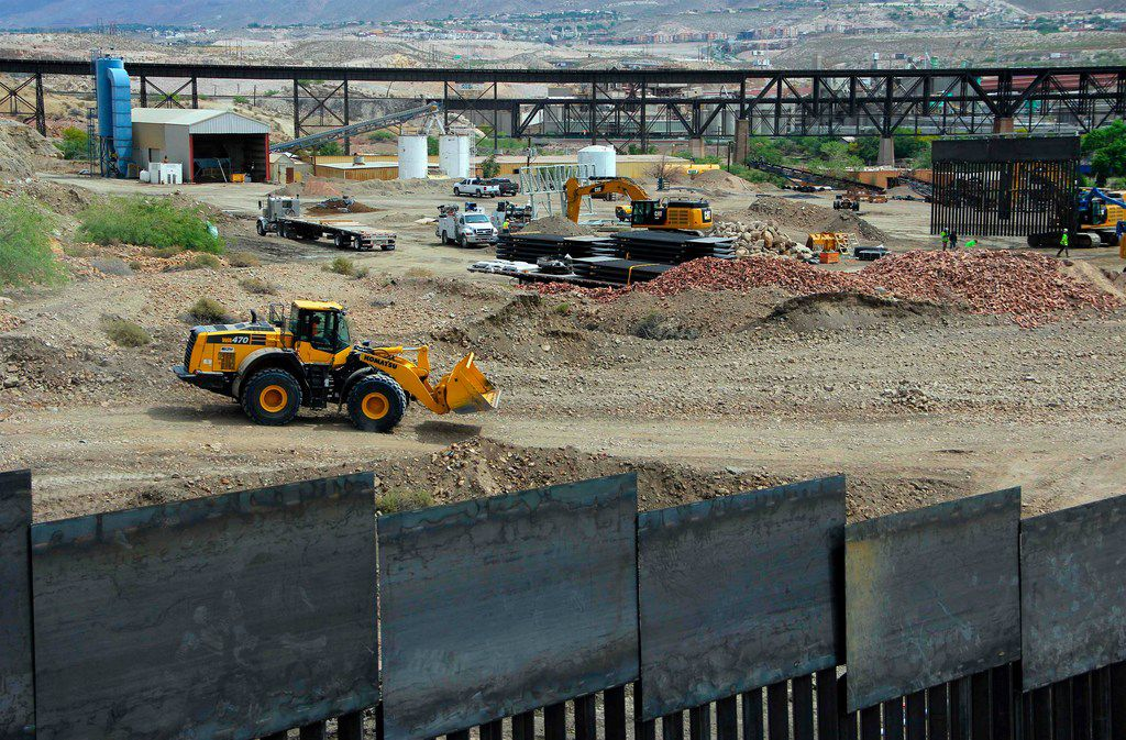 Workers build a section of border fence on private property in Sunland Park, N.M.