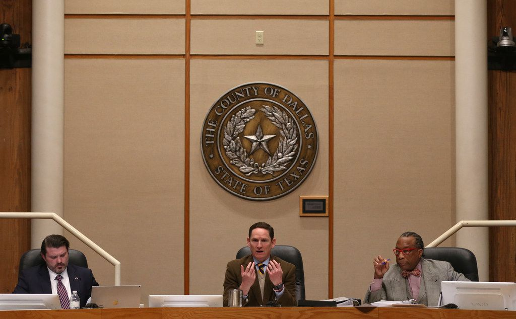 Dallas County Judge Clay Jenkins (middle) spoke alongside Dallas County Commissioners J.J. Koch (left) and John Wiley Price during a Dallas County Commissioners Court meeting on Tuesday, Feb. 19, 2019.