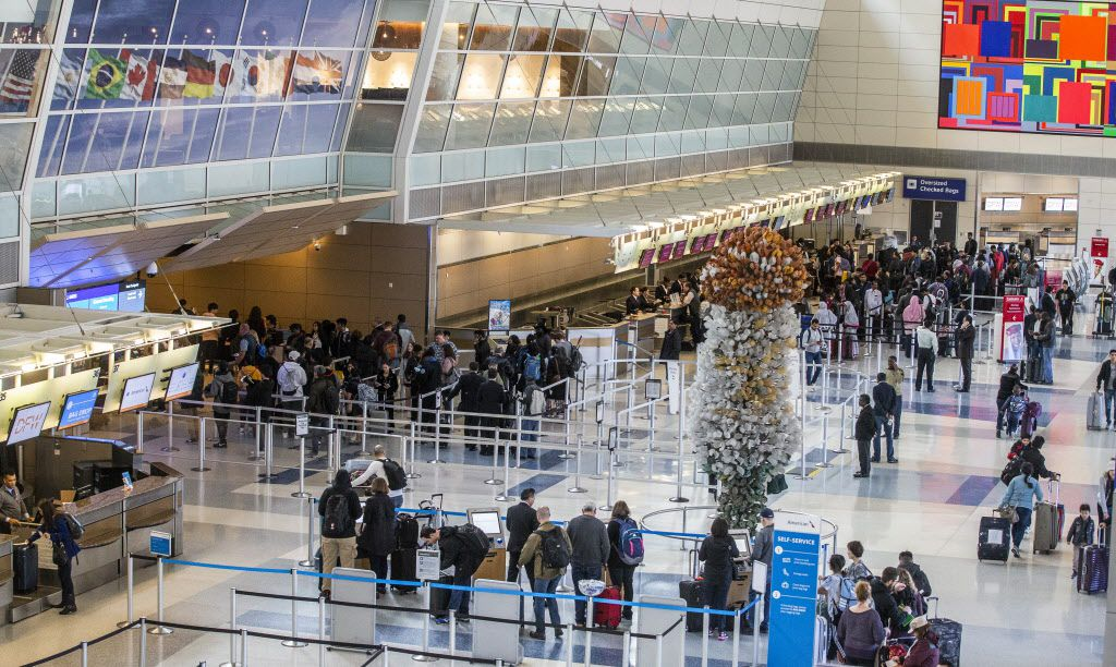 Travelers make their way thought at DFW International Airport security Terminal D on Friday, Dec. 21, 2018. This terminal was opened in 2005.