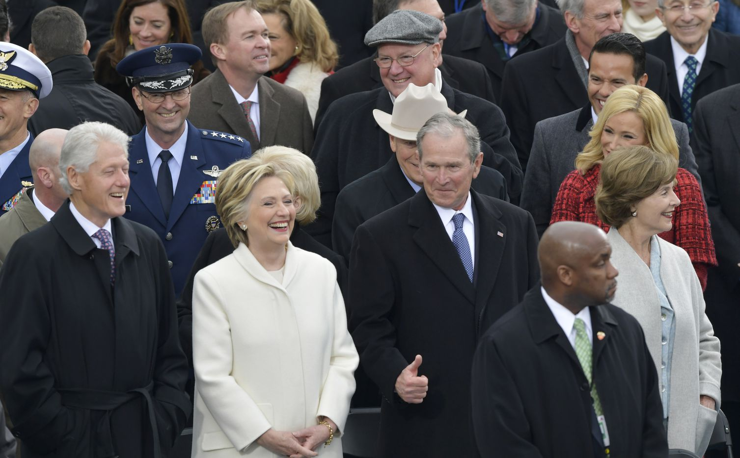 Former President George W. Bush, right, his wife Laura, Former Secretary of State Hillary Clinton and Former President Bill Clinton wait for the 58th Presidential Inauguration for President-elect Donald Trump.