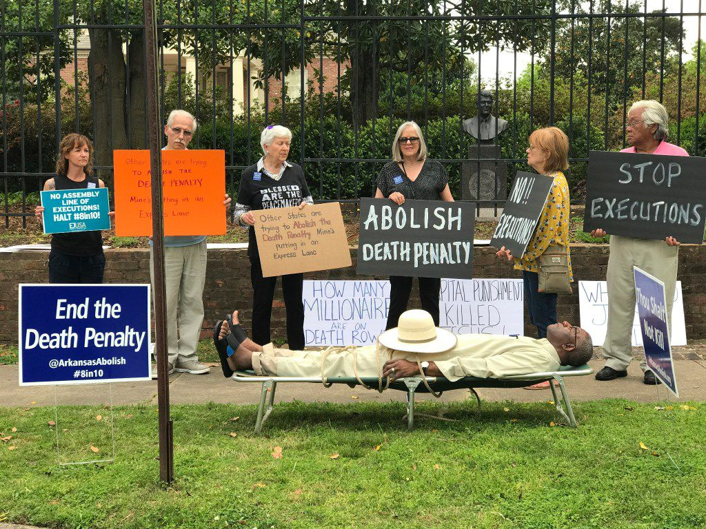 Pulaski County, Ark., Circuit Judge Wendell Griffen camps out on a cot at an anti-death penalty demonstration outside the Governor's Mansion in Little Rock.