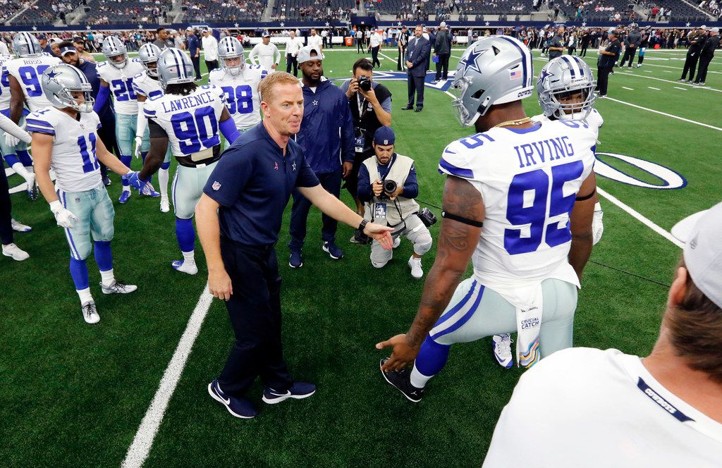 Dallas Cowboys head coach Jason Garrett greets defensive tackle David Irving (95) who is suited up for the game against the Jacksonville Jaguars at AT&T Stadium in Arlington, Texas, Sunday, October 14, 2018. (Tom Fox/The Dallas Morning News)