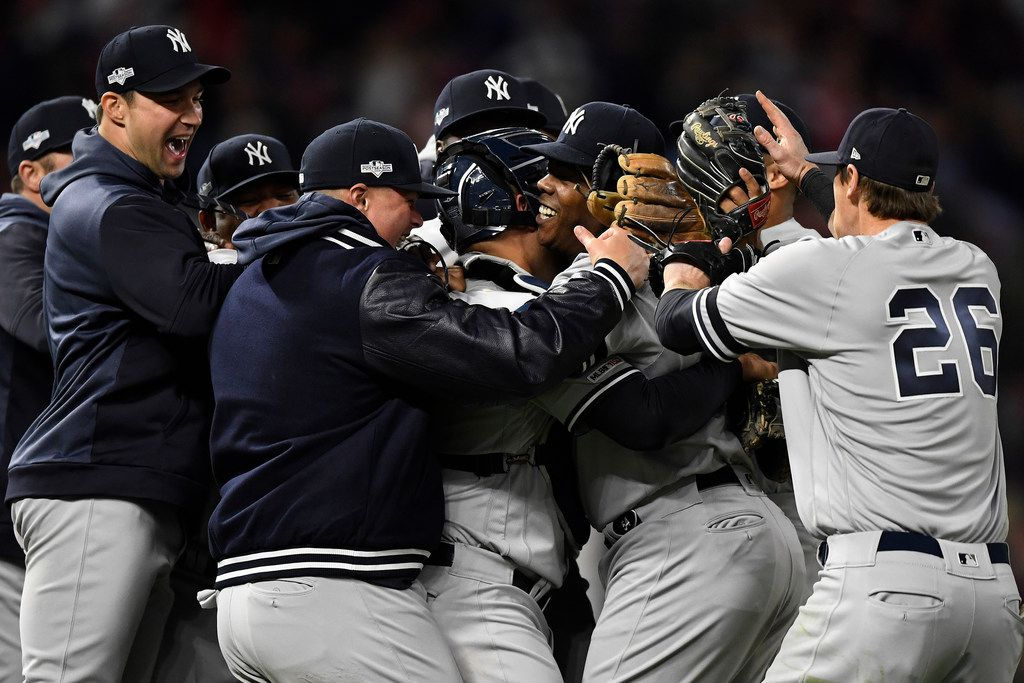 MINNEAPOLIS, MINNESOTA - OCTOBER 07: Aroldis Chapman #54 and the New York Yankees celebrate after the final out defeating the Minnesota Twins 5-1 in game three of the American League Division Series to advance to the American League Championship Series at Target Field on October 07, 2019 in Minneapolis, Minnesota. (Photo by Hannah Foslien/Getty Images)