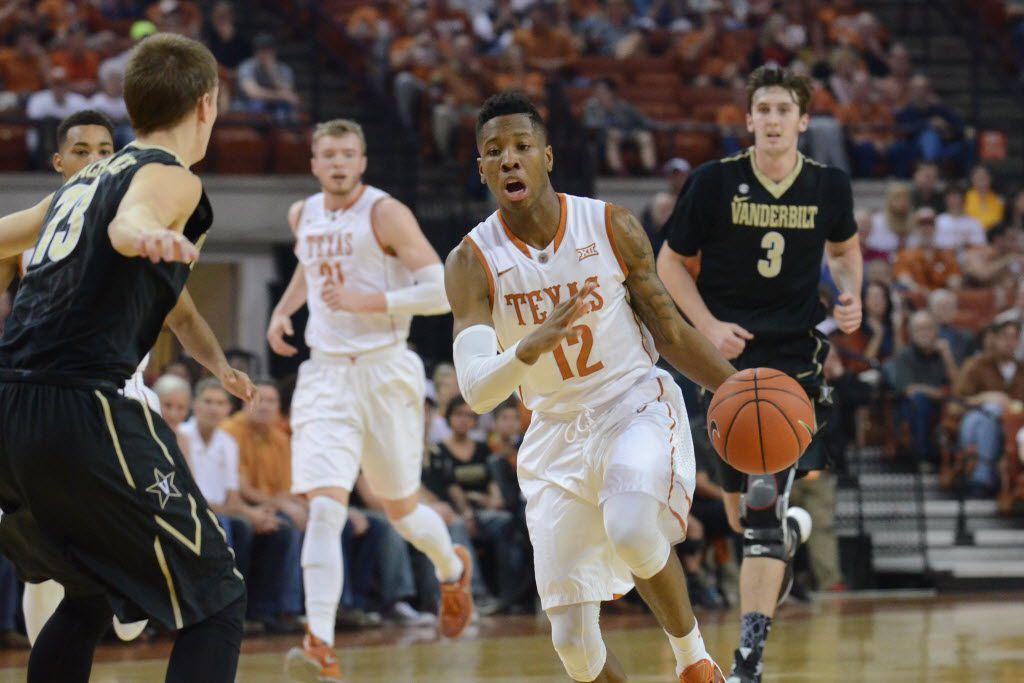 Jan 30, 2016; Austin, TX, USA; Texas Longhorns guard Kerwin Roach (12) dribbles around Vanderbilt Commodores guard Riley LaChance (13) during the first half at the Frank Erwin Special Events Center. Texas won 72-58. Mandatory Credit: Brendan Maloney-USA TODAY Sports