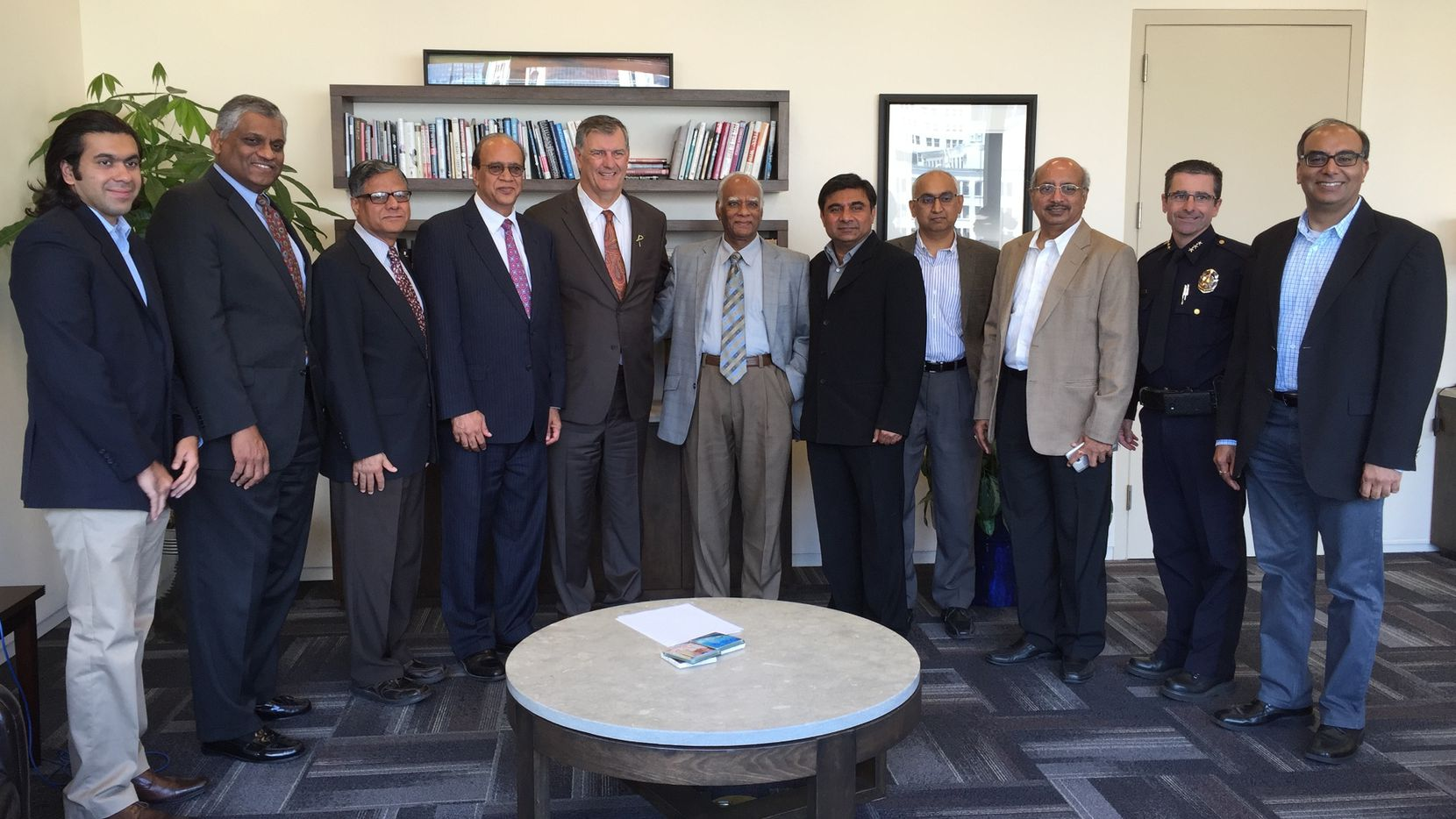 Local Indian-American leaders joined Dallas Mayor Mike Rawlings (fifth from left) and Executive Assistant Police Chief David Pughes (second from right) to present a $60,000 gift to the Assist the Officer Foundation.