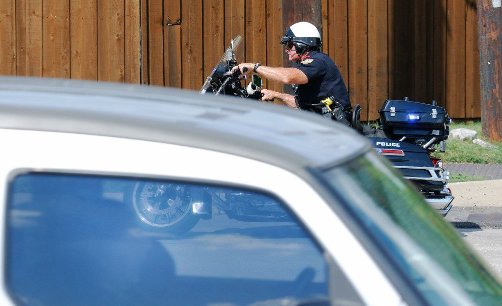 Garland police officer Lanny Orman chases a motorist for texting on their phone while driving through a school zone at Ida Handley Elementary on Broadway Blvd in Garland.