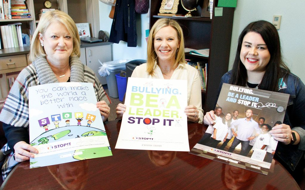 Ashley Elementary counselor Laurie Ortel (from left), principal Kim Frankson and assistant principal Jess Johnson with posters for the anti-bullying app STOPit. The three administrators received a cry for help via the app from a student in Virginia just before winter break.