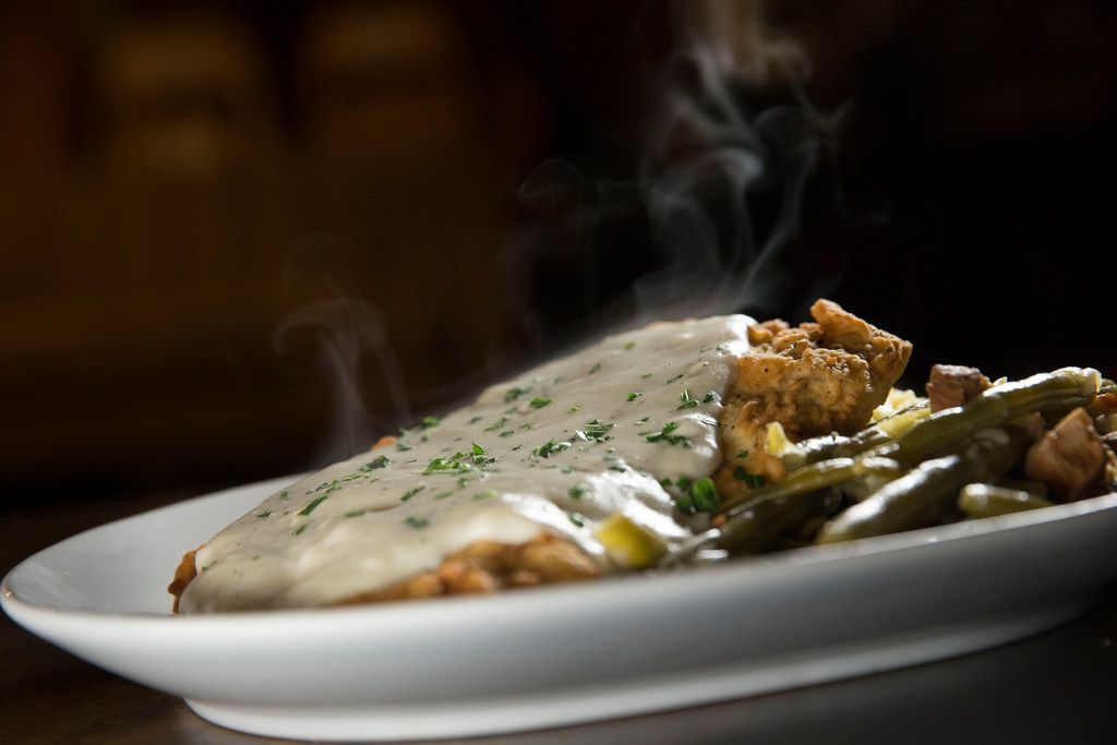 Smoked chicken-fried steak with mashed potatoes, braised green beans and gravy