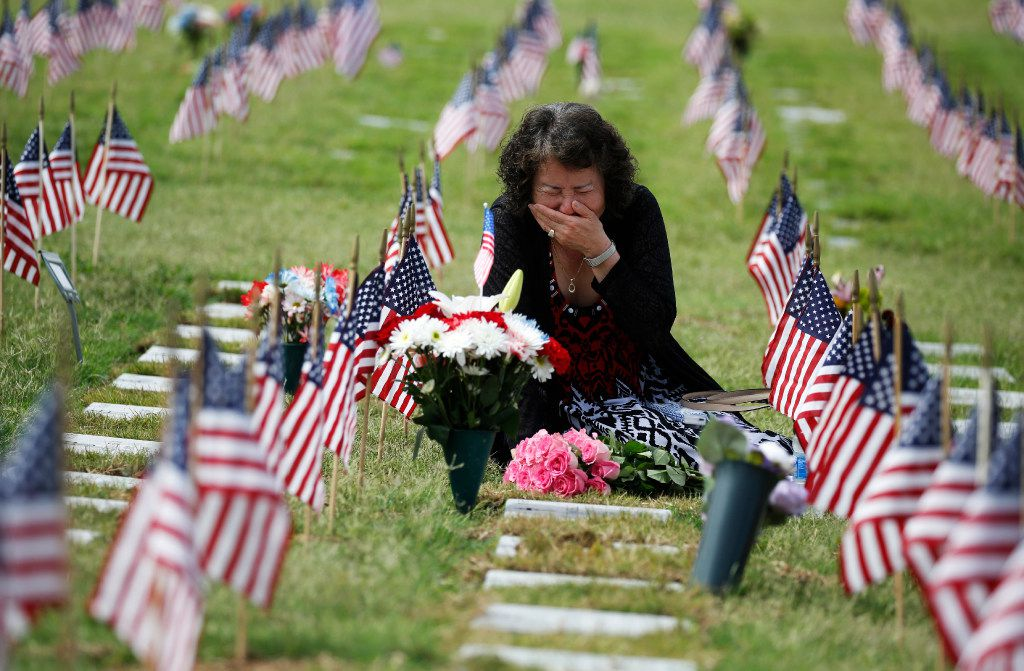 Una Pemberton, of Wichita Falls cries at the grave of her son, Clem J. Strait III, who served in the U.S. Army in the Persian Gulf War. She honored him during the DFW National Cemetery Memorial Day celebration at the Dallas-Fort Worth National Cemetery in Dallas on May 29, 2017. (File/Staff Photo)