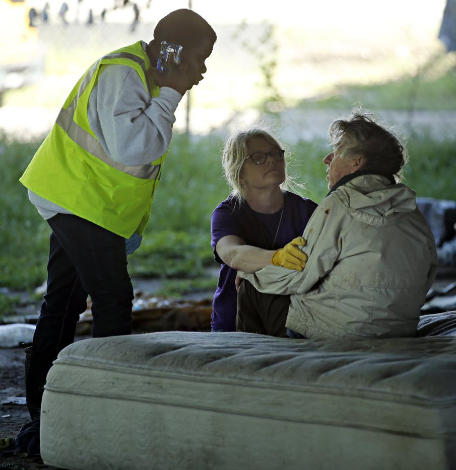Cindy Crain (center), president of the Metro Dallas Homeless Alliance, talks with a resident at Tent City Tuesday, May 3, 2016 in Dallas. The final two sections of the contentious homeless encampment where closed Tuesday morning, sending the remaining residents scrambling for shelter.
