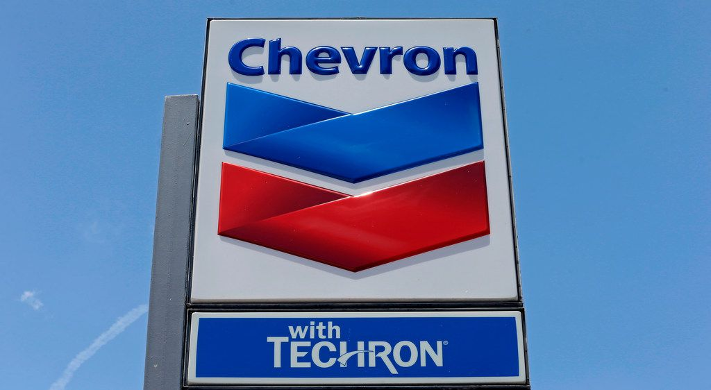 FILE - This May 2, 2017 file photo shows a Chevron sign at a gas station in Miami, Fla. Chevron says it won't boost its $33B takeover offer for Anadarko, just days after Anadarko said it now favors a revised bid by Occidental Petroleum. Anadarko will have to pay a $1B fee for terminating its deal with Chevron.  (AP Photo/Alan Diaz, File)