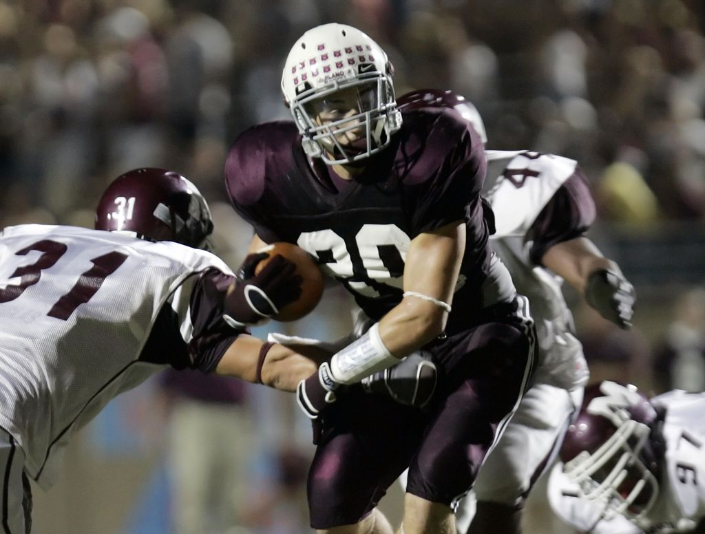 Plano running back Rex Burkhead  (20) cuts  between Mesquite outside linebacker Ben Robinson (31) and inside linebacker Robert Lewis (44) in the second quarter of their pre-district football game between Plano High School and Mesquite High School in Plano, Texas, Friday, August 31, 2007.