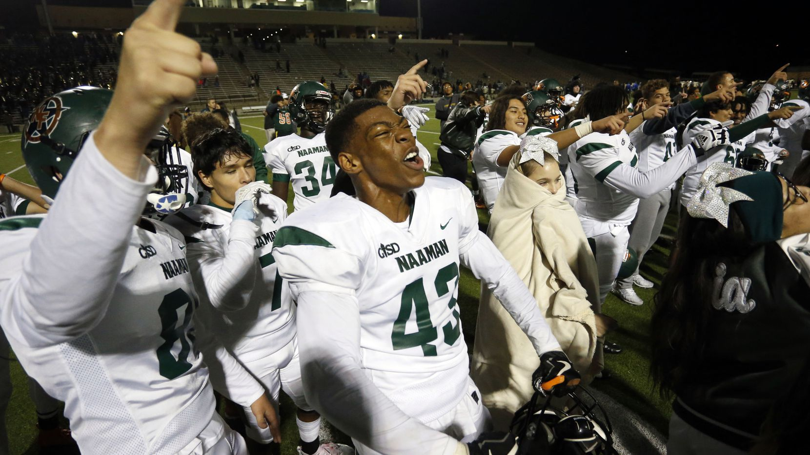 Naaman Forest players, including Nick Abengowe (43), celebrate their 42-27 win over Lakeview Centennial in a high school football game at Homer B. Johnson Stadium on Friday, November 8, 2019.