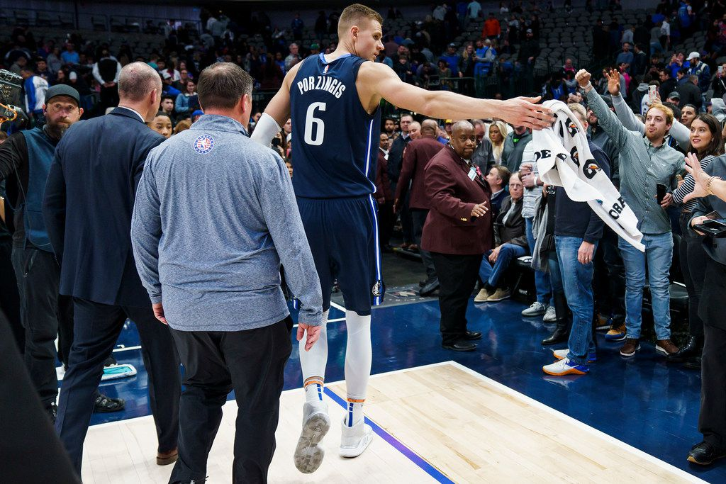 Dallas Mavericks forward Kristaps Porzingis tosses a towel to the crowd as he leaves the court after a loss to the New York Knicks in an NBA basketball game at American Airlines Center on Friday, Nov. 8, 2019, in Dallas. (Smiley N. Pool/The Dallas Morning News)