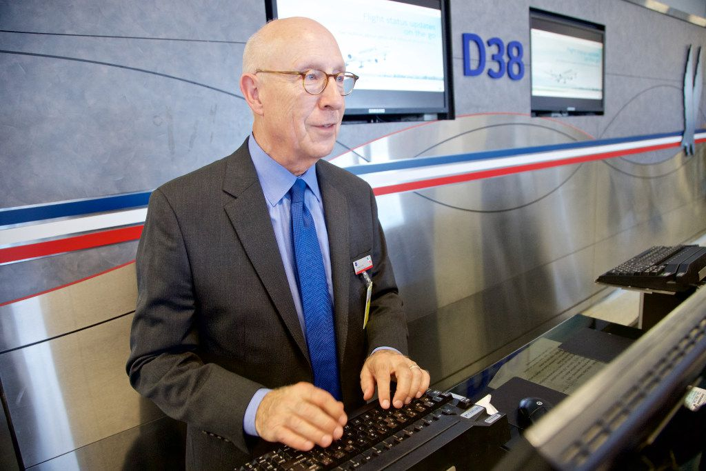 American Airlines Customer Service Agent Jim Harrelson poses for a photo, wearing one of the airline's new uniforms, at DFW Airport, Tuesday, September 20, 2016. (Brandon Wade/Special Contributor)