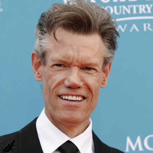 FILE - This April 18, 2010 file photo shows singer Randy Travis at the 45th Annual Academy of Country Music Awards in Las Vegas. Travis suffered a stroke in 2013 and is now releasing a memoir.