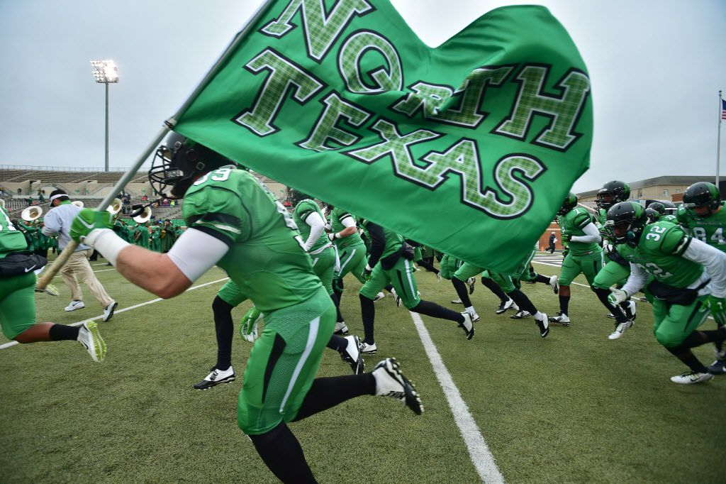 The North Texas Mean Green take the field before kickoff against Texas-El Paso, Saturday, November 28, 2015, at Apogee Stadium in Denton, TX. David Minton/DRC
