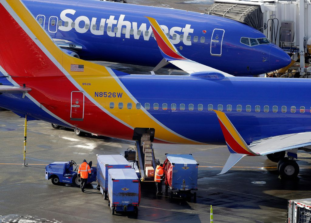 FILE - In this Feb. 5, 2019, file photo, Southwest Airlines planes are loaded at Seattle-Tacoma International Airport in Seattle. A high-ranking federal regulator is telling Southwest Airlines and its mechanics union that their bitter fight could hurt the airline's safety program. (AP Photo/Ted S. Warren, File)