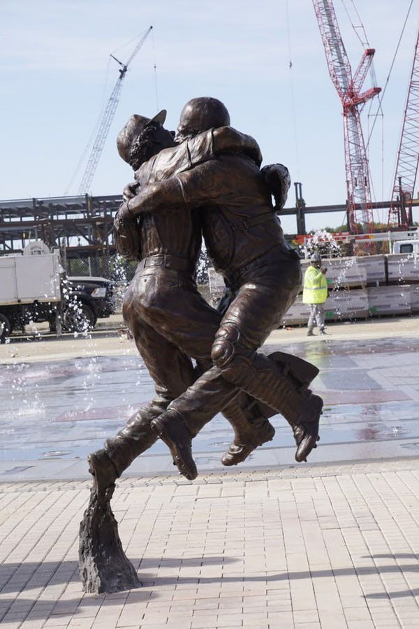 "The Texas Rangers unveiled the statue ""Going To The Show"" at the new Globe Life Field in Arlington, Texas on August 7, 2018. The statue captures the celebration between Benjie Molina and Neftali Feliz when they beat the Yankees to clinch the teams first World Series appearance."
