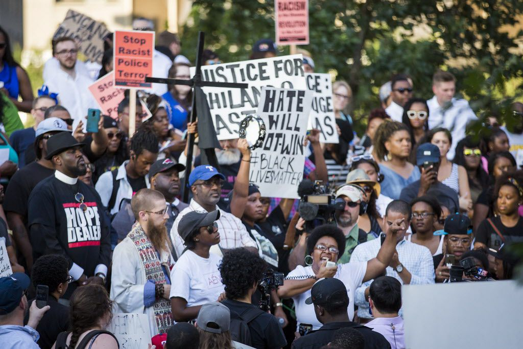 Plinks Green speaks while surrounded by protestors at a rally in downtown Dallas on Thursday, July 7, 2016. Dallas protestors rallied in the aftermath of the killing of Alton Sterling by police officers in Baton Rouge, Louisiana and Philando Castile, who was killed by police less than 48 hours in Minnesota. (Smiley N. Pool/The Dallas Morning News)