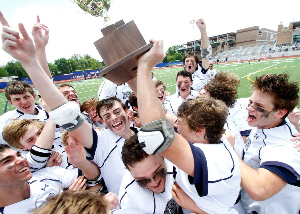 Members of the Episcopal School of Dallas lacrosse team break out in euphoria after being presented the championship trophy following their 14-6 victory over St. Mark's. The SPC boys lacrosse championship game was held at Jones Stadium at Episcopal School of Dallas on April 27, 2019. (Steve Hamm/ Special Contributor)