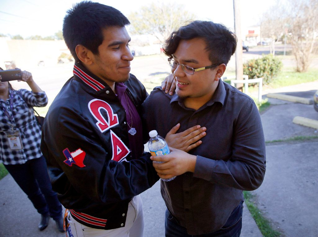 Edwin Romero, a Mexican immigrant with DACA, gets a hug from his friend Roy Ferretiz at a news conference. (Tom Fox/The Dallas Morning News)