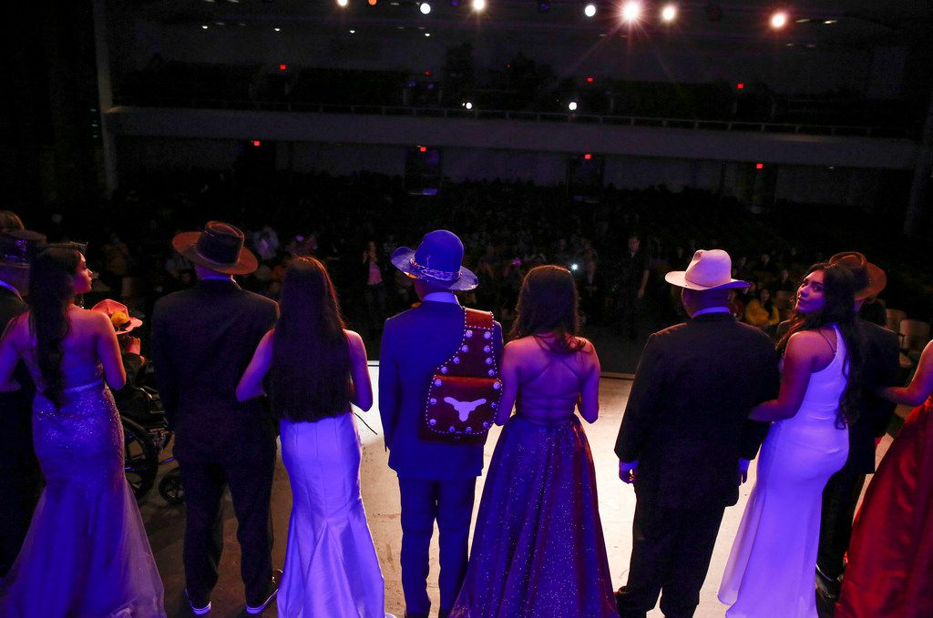 Special-needs students wearing new suits escort members of school dance team during a fashion show at Thomas Jefferson High School in Dallas on Wednesday, May 8, 2019. The Mark Cuban Heroes Basketball Center's Suit Up Experience provided custom made suits from Lombardo Custom Apparel for 10 young men.