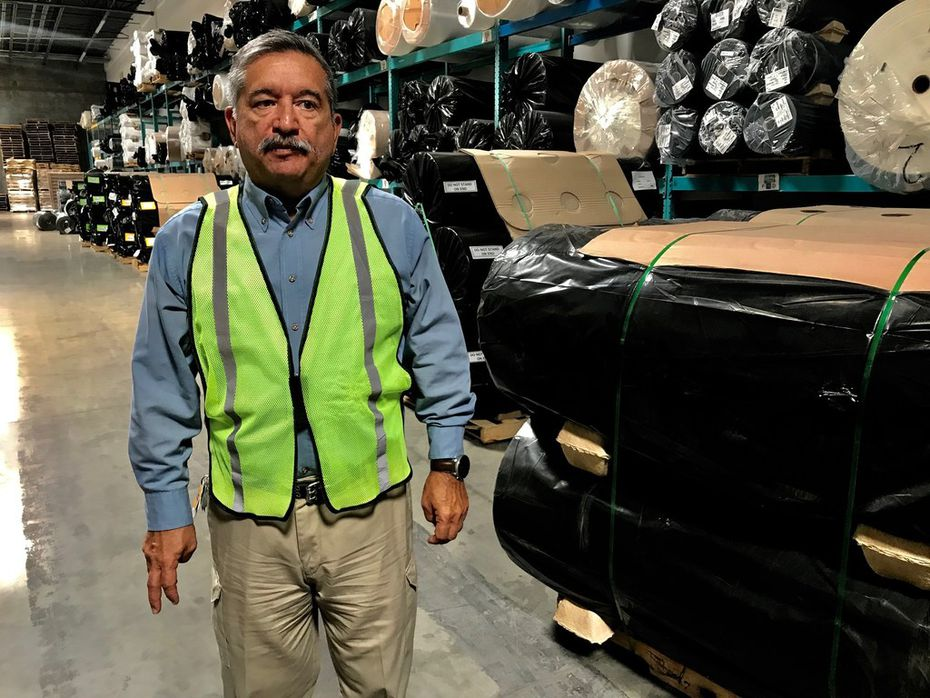 Alexander Sierra, plant manager at ACME mills, walks through his distribution warehouse June 5 in Santa Teresa, N.M., on the border with Texas. He worries about possible tariffs proposed by President Donald Trump.