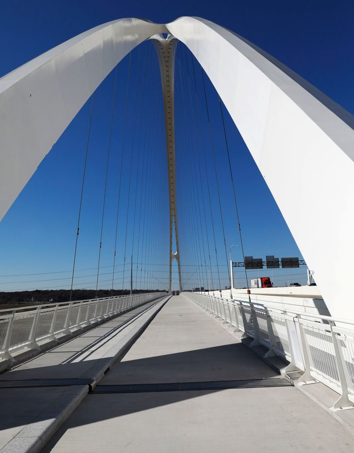 Arches rise over the pedestrian and bike lanes of the Margaret McDermott Bridge over the Trinity River