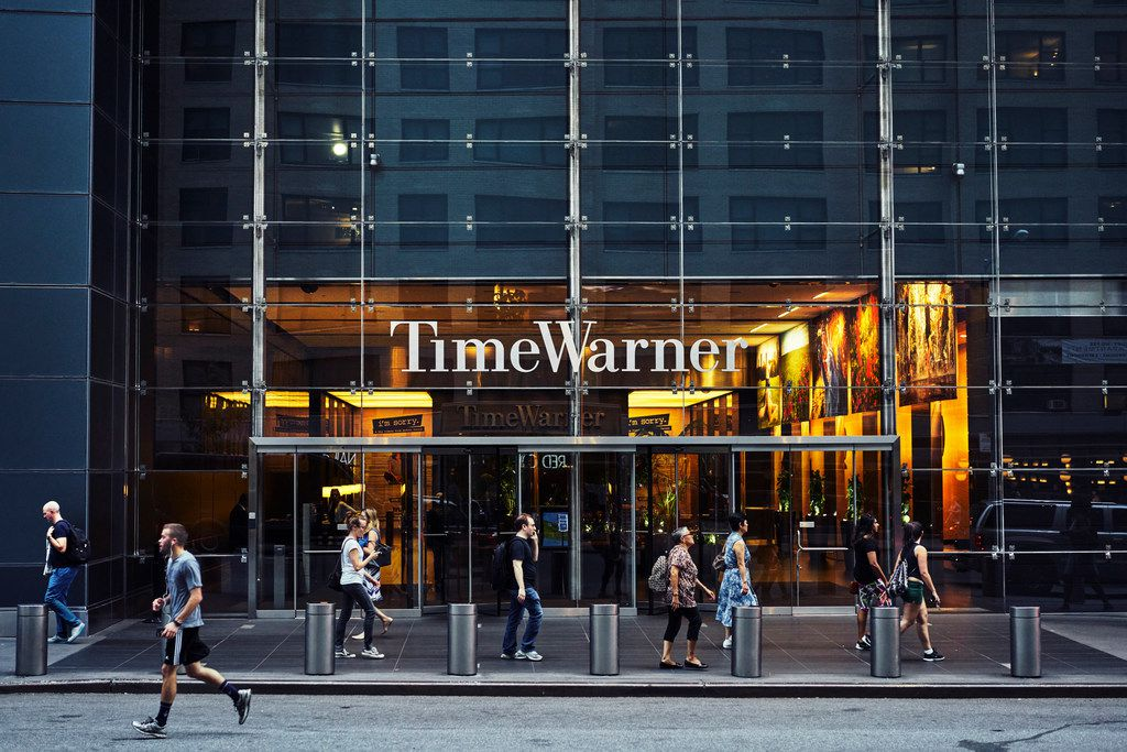-- PHOTO MOVED IN ADVANCE AND NOT FOR USE - ONLINE OR IN PRINT - BEFORE MARCH 18, 2018. -- FILE— Outside of the Time Warner Building in New York, July 20, 2017. AT&T and the Justice Department will lock horns in court to determine if the telecommunications giant will be allowed to absorb the entertainment powerhouse Time Warner. (An Rong Xu/The New York Times)