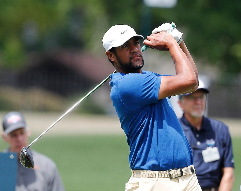 Tony Finau hits off the 18th tee during the first round of the Charles Schwab Challenge golf tournament at Colonial Country Club in Fort Worth, Texas, Thursday, May 23, 2019. (Bob Booth/Star-Telegram via AP)