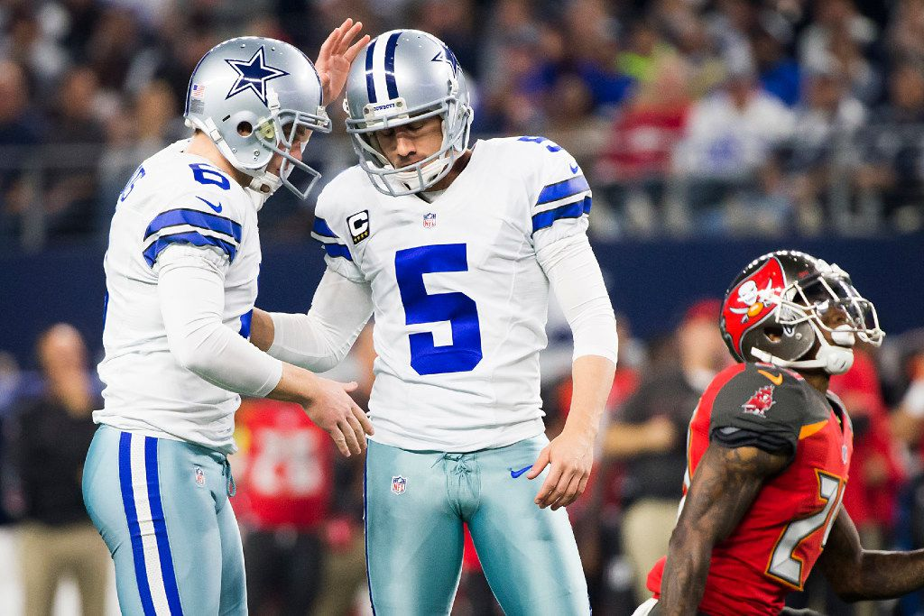 Dallas Cowboys kicker Dan Bailey (5) celebrates with punter Chris Jones (6) after connecting on a 40-yard field goal during the fourth quarter of an NFL football game at AT&T Stadium on Sunday, Dec. 18, 2016, in Arlington. The Cowboys won the game 26-20. (Smiley N. Pool/The Dallas Morning News)