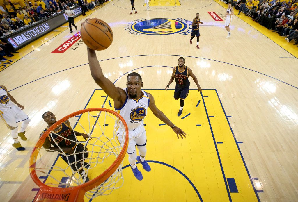 OAKLAND, CA - JUNE 01:  Kevin Durant #35 of the Golden State Warriors dunks the ball against the Cleveland Cavaliers in Game 1 of the 2017 NBA Finals at ORACLE Arena on June 1, 2017 in Oakland, California. NOTE TO USER: User expressly acknowledges and agrees that, by downloading and or using this photograph, User is consenting to the terms and conditions of the Getty Images License Agreement.  (Photo by Ezra Shaw/Getty Images)