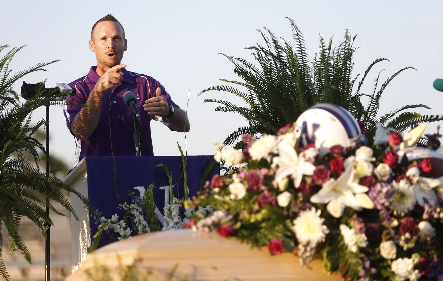 """Pastor Jason Fortenberry delivers a message during the memorial service for Newton High School head football coach William Theodore """"W.T."""" Johnston at Curtis Barbay Field at Newton High School in Newton, Texas on Wednesday, May 15, 2019. (Vernon Bryant/The Dallas Morning News)"""