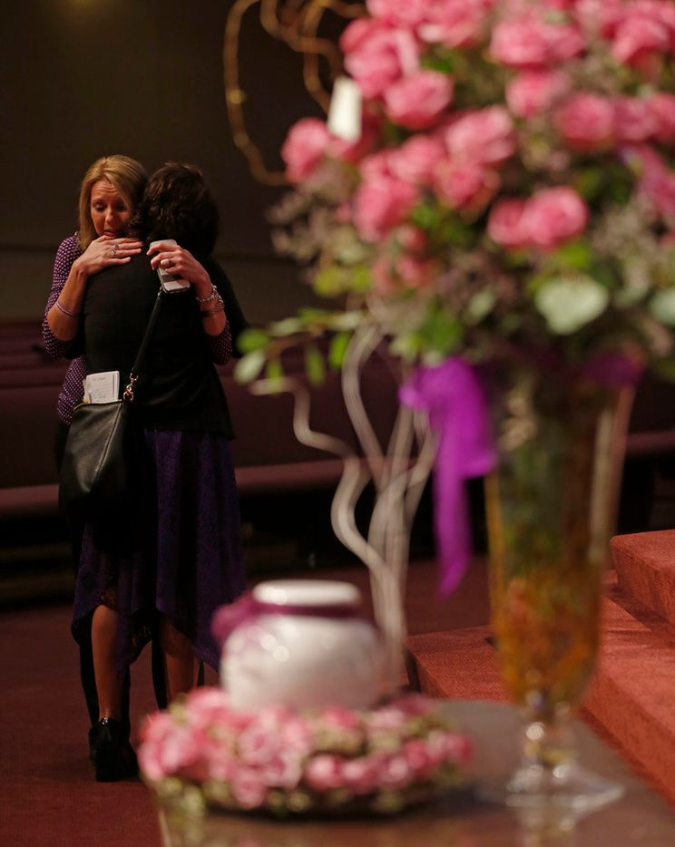 Angel Jenkins, left, of Team Christina hugs Jonni Hare, mother of kidnap victim Christina Morris, before a memorial service begins at First Baptist Church in Allen, Texas, Saturday, April 21, 2018.