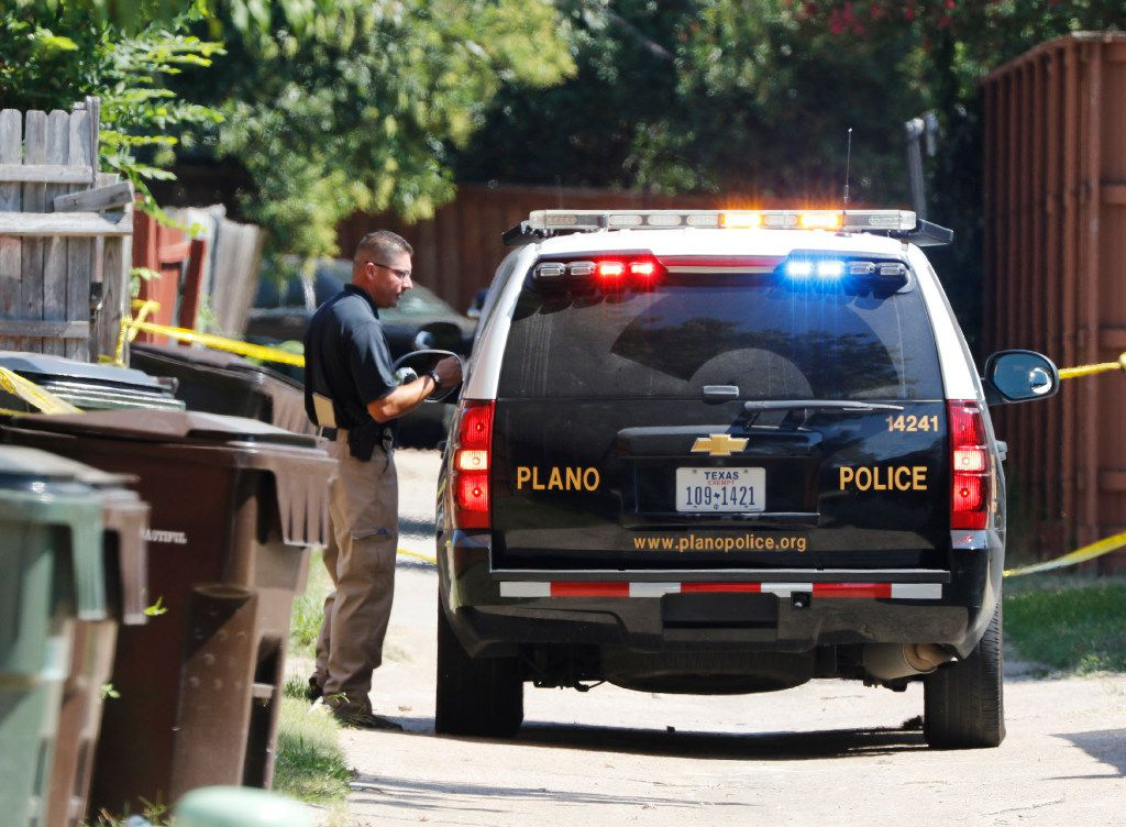 Plano police and the Texas Rangers work the scene of a shooting Sunday night at a home in the 1700 block of West Spring Creek Parkway in Plano. Eight people were fatally shot, and their attacker was killed by a police officer.