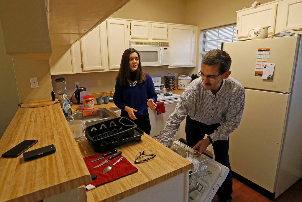 Sara Mohammed Saleem (left) talks with her father Faris Saleh in the kitchen at their home in Plano, Texas, Thursday, Feb. 1, 2018. (Jae S. Lee/The Dallas Morning News)
