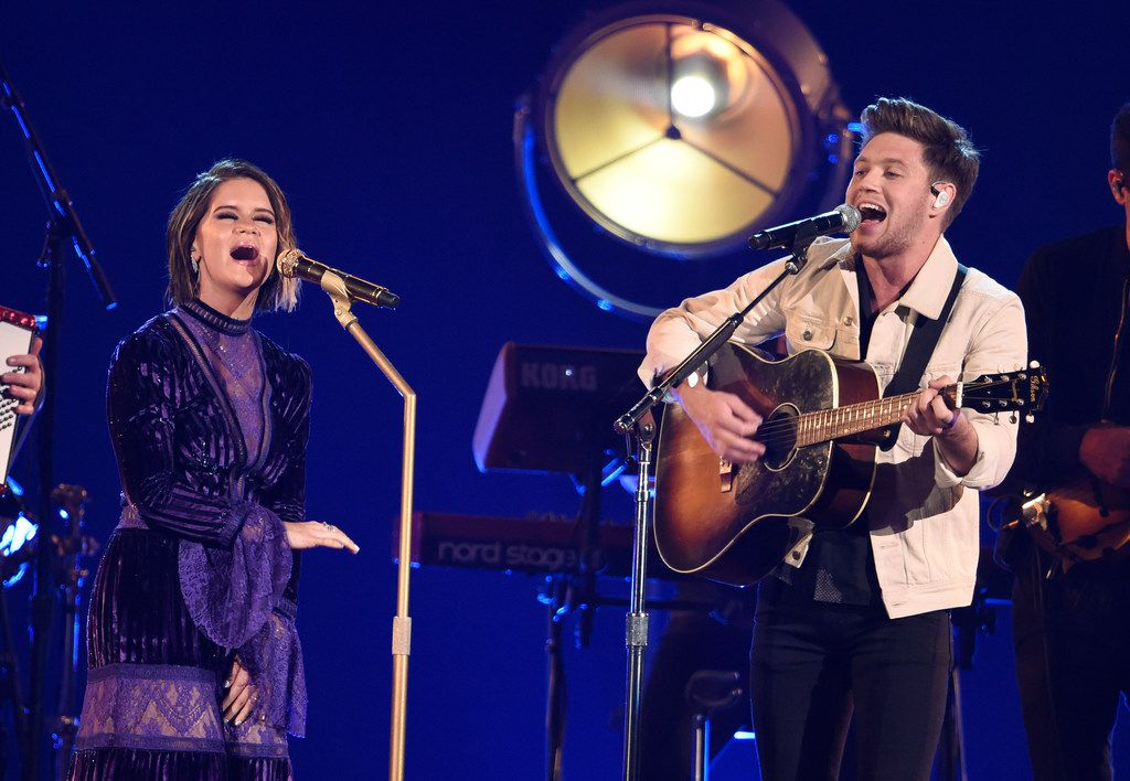 Maren Morris, left, and Niall Horan perform at the 51st annual CMA Awards at the Bridgestone Arena on Wednesday, Nov. 8, 2017, in Nashville, Tenn.