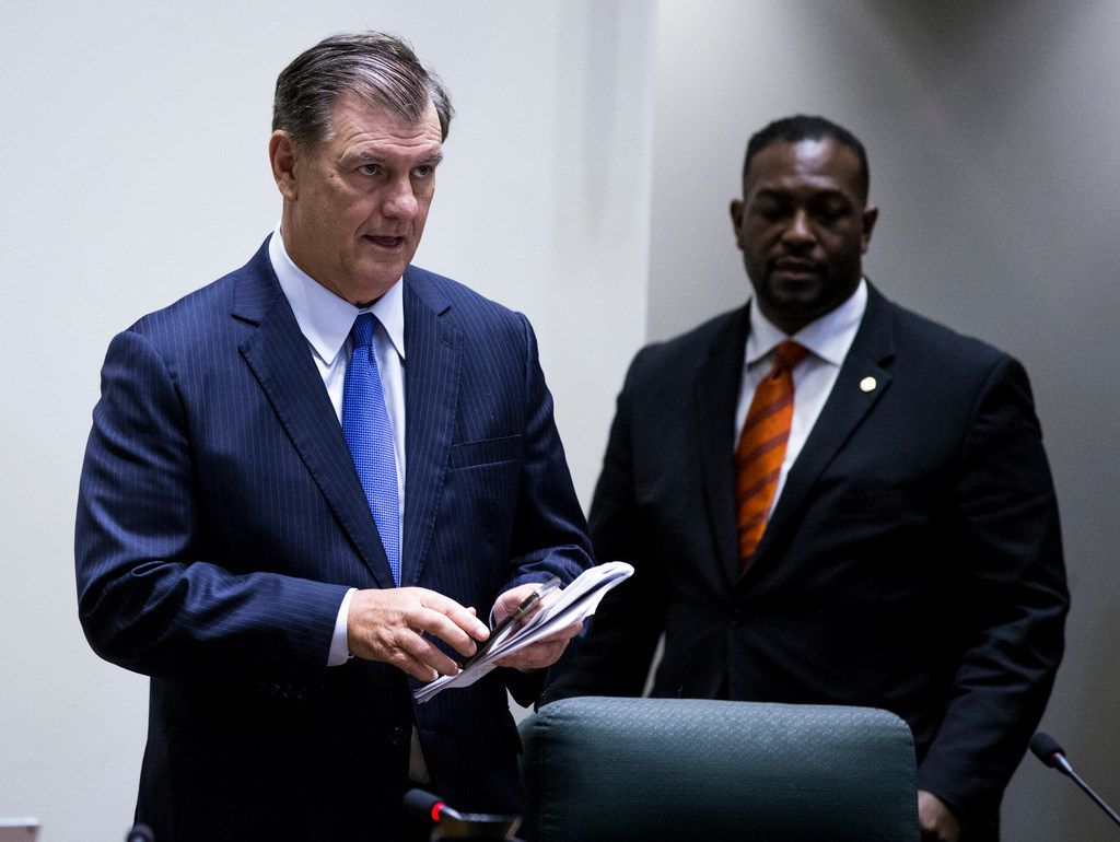 Dallas Mayor Mike Rawlings (left) met with activists in a closed-door session during Wednesday's Dallas City Council meeting.
