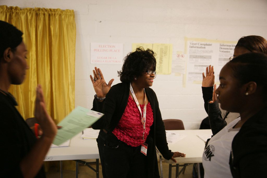 Poll workers take the Oath of Assistance administered by judge Tammy Britton (far left) at voting precinct 3045 at Gethsemane Missionary Baptist Church on Solar Lane in the Joppa neighborhood of Dallas before polls open on Election Day Tuesday November 8, 2016. (Andy Jacobsohn/The Dallas Morning News)