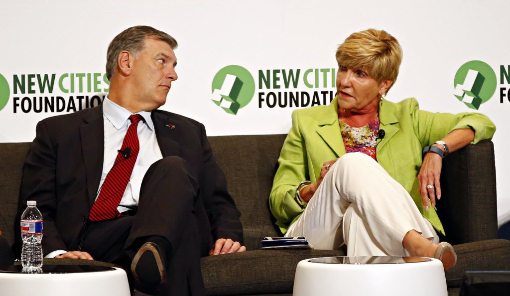 Dallas Mayor Mike Rawlings (left) listened as Fort Worth Mayor Betsy Price talked on a panel during the New Cities Summit 2014.