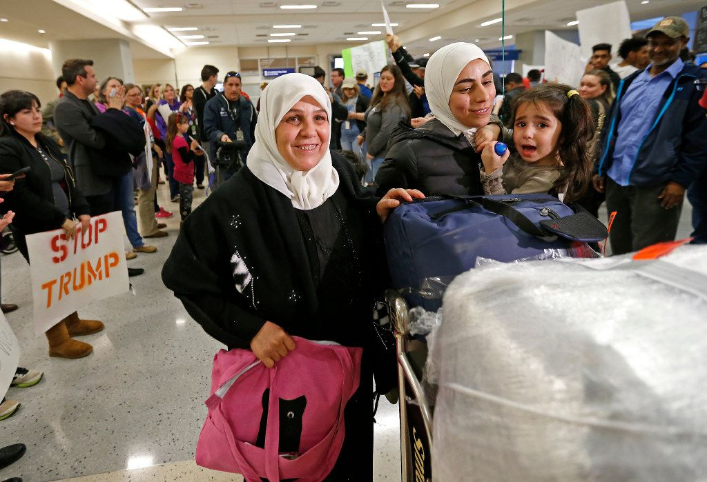 Najah Alshamieh (left) from Syria leaves Terminal D of DFW International Airport in Dallas after being held inside and later released on Saturday, Jan. 28, 2017. With her is her daughter Mariam Yasin.  (Jae S. Lee/The Dallas Morning News)