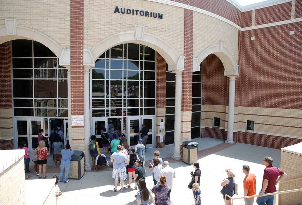McKinney North High School parents wait in line to pick up students as a line forms at McKinney Boyd High School after reports of a lockdown at the McKinney North last week.