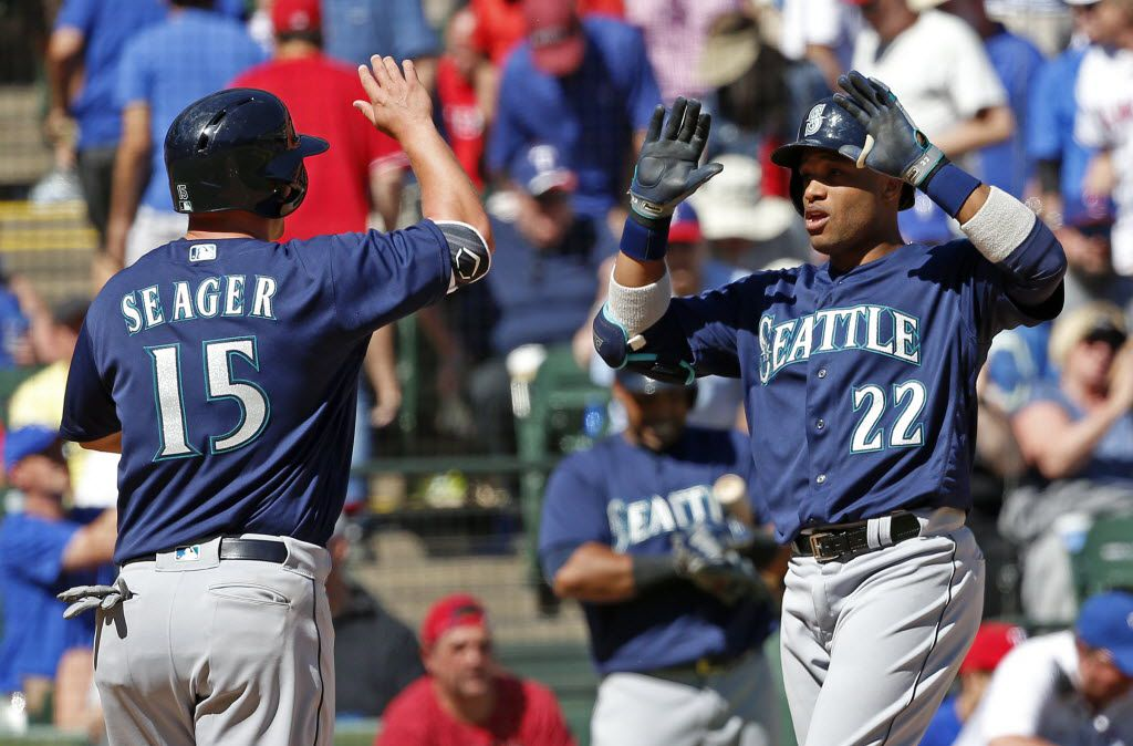 Seattle Mariners second baseman Robinson Cano (22) celebrates his two-run homer with third baseman Kyle Seager in the 9th inning against Texas Rangers at Globe Life Park in Arlington, Texas, Wednesday, April 6, 2016. Texas Rangers lost 9-5. (Jae S. Lee/The Dallas Morning News)