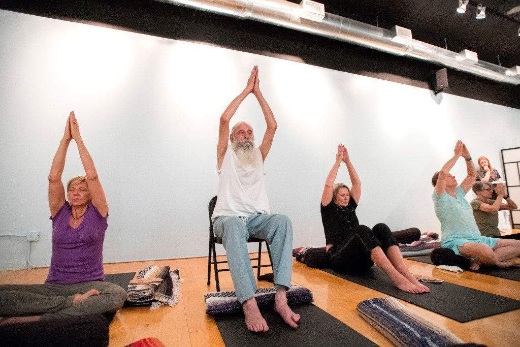 Karen Cangemi, Joshua Lloyd, Christine Cerny (left to right) participate in a trauma-sensitive yoga session offered by the non-profit Warrior Spirit Project on Friday, July 21, 2017 at Studio 4 in the Bishop Arts Co-op in Dallas. Warrior Spirit Project seeks to help military veterans and first-responders heal from trauma through yoga, a support dog program, and gardening. (Jeffrey McWhorter/Special Contributor)
